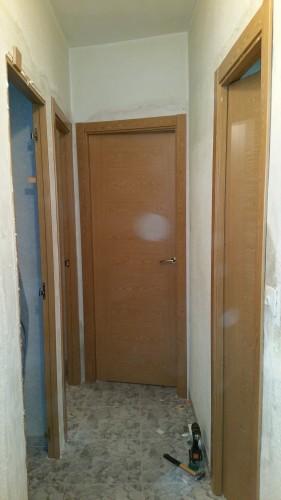 portfolio 221/287  - colocación de precercos y puertas de interior en una vivienda